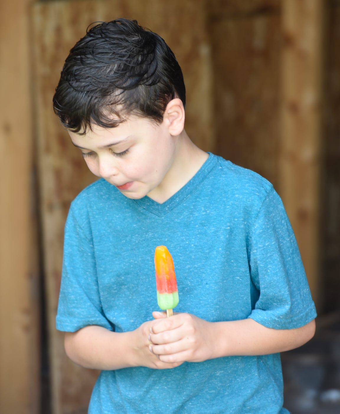 Carter Newville-Larson eats a popsicle Tuesday, July 2, 2019.