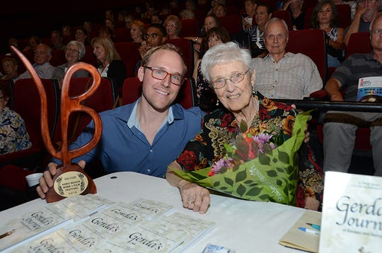 "Vero Visions Award winner Kenneth George, left, poses with Gerda Smith, the subject of his film ""Let the Lovely Sun In."""