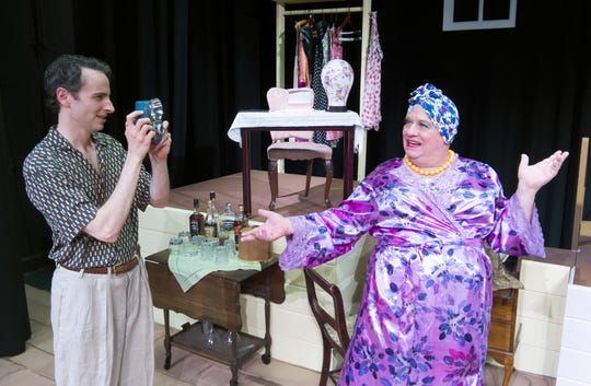 "Bessie, right, played by Allan Noel, is always ready to pose for impromptu snapshots by Jonathon, played by Mike Adams, in Harvey Fierstein's ""Casa Valentina,"" a comedy playing through July 28 at the Santa Paula Theater Center."