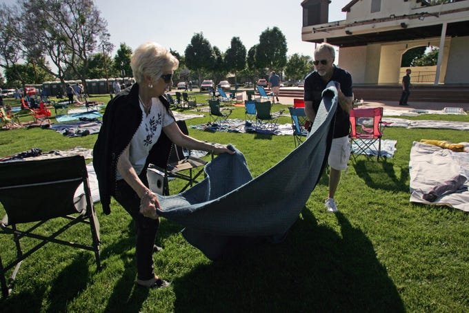 Judi McKay and her husband, Clark, set up their seating area on June 28 as concertgoers reserved their seats a day before the June 29 concert at Constitution Park in Camarillo. Saving seats for the concerts is a Camarillo tradition.