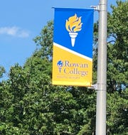 Rowan College of South Jersey banners tout the new identity of the former Cumberland County College.