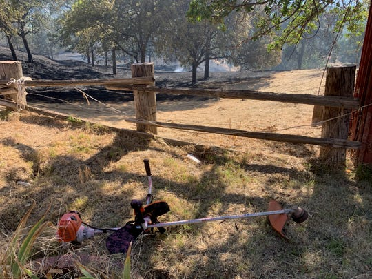 """These folks weed-eated around their house last week. This is a great illustration for keeping clearance around houses,"" Cal Fire Capt. Tom Trass said."