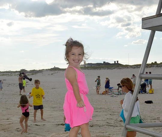 A photo of Saige Pfeffer, the two-year old daughter of Heather Landau, MD and her husband Daniel Pfeffer of Greenburgh, who died in an accidental drowning in 2015. The couple spoke at a news conference about pool safety at Saxon Woods Park in White Plains July 2, 2019.