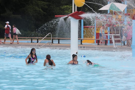 Children enjoy the pool at Saxon Woods Park in White Plains July 2, 2019. Westchester County officials held a news conference at the pool to highlight the importance of pool safety for children. Heather Landau, MD and her husband Daniel Pfeffer, whose daughter died in an accidental drowning in 2015 spoke at the news conference.