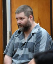 Jason Wayne Carlile at a status hearing Tuesday morning in 78th District Court.