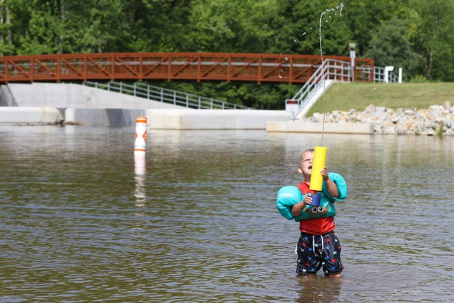 Henry Boyer, 2, of Rushville plays in the water at Blue Rock State Park. Recreation on Cutler Lake has resumed after a year-long rebuild of the park's dam.