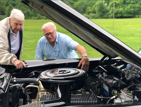 Fred Grant III and Art Moose look over the engine of the 1956 Lincoln Continental Mark II that Moose recently restored. The car was originally owned by Grant's mother, Ethel Weller Curphey.