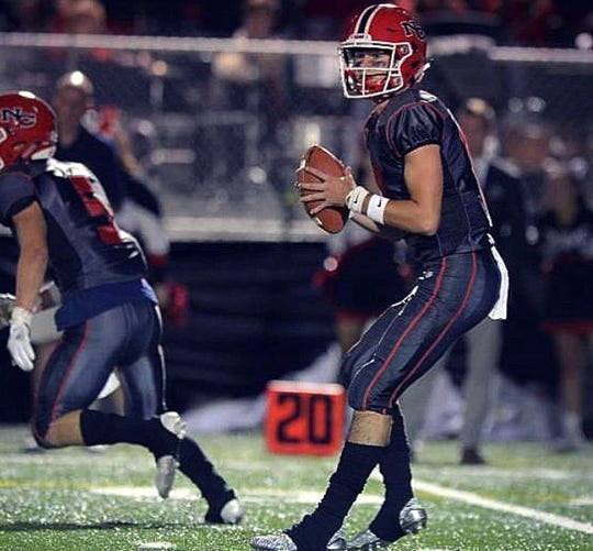 Drew Pyne looks to throw during a game with New Canaan High School.
