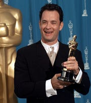 "Tom Hanks celebrates his best actor Oscar win in 1995 - his second in a row - for ""Forrest Gump."""