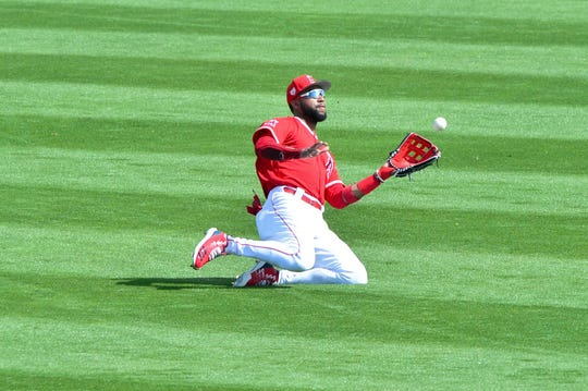 Jo Adell catches a fly ball in the third inning against the Brewers at Tempe Diablo Stadium during spring training.