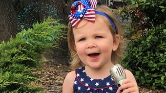 This sailor's daughter is singing her heart out for America.