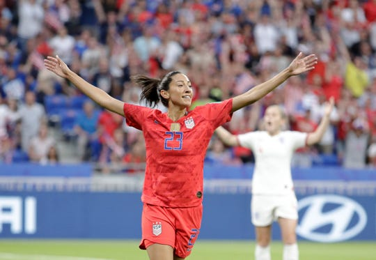 Christen Press celebrates after scoring the opening goal for the U.S. during their semifinal clash against England.