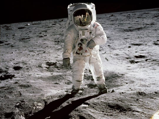 "A photo made available by NASA shows astronaut Edwin ""Buzz"" Aldrin walking on the moon in an iconic image taken by Apollo 11 commander Neil Armstrong on July 20, 1969."
