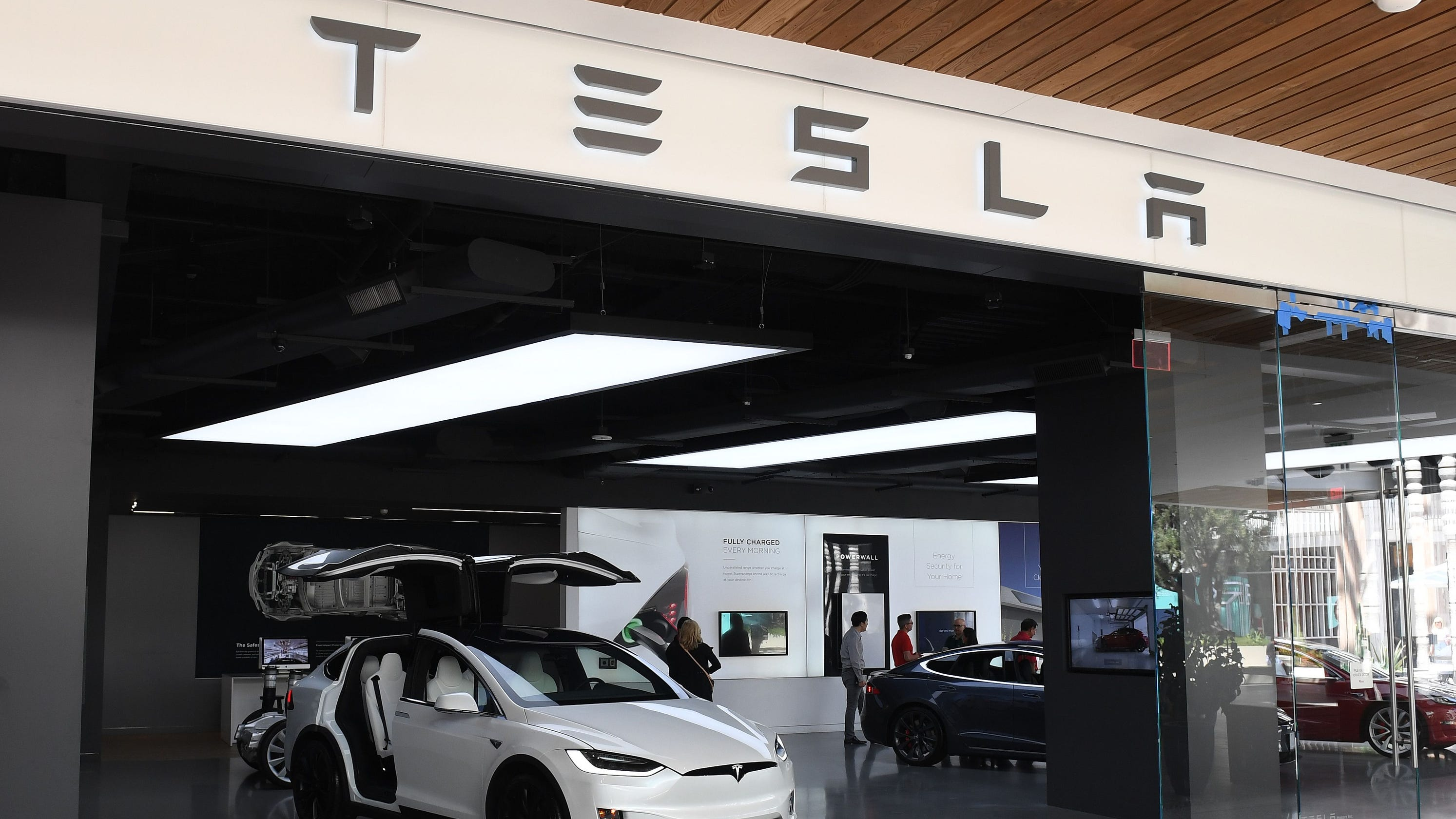 Tesla's stock surges as company breaks delivery and