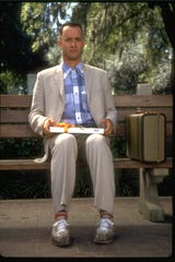 """Tom Hanks holds his box of chocolates in """"Forrest Gump."""""""
