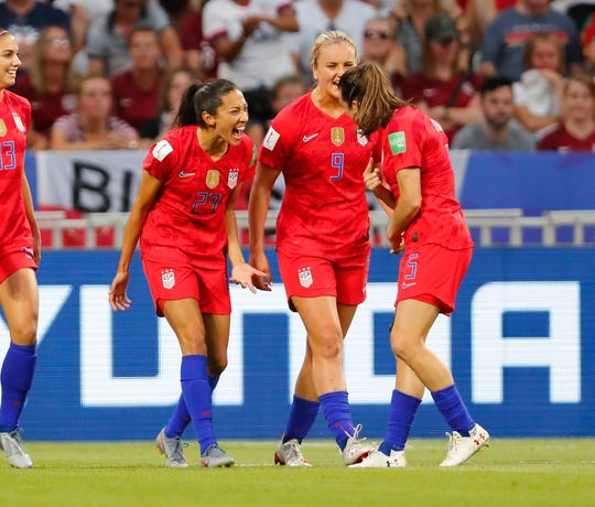 United States forward Christen Press (23) celebrates with teammates after scoring a goal against England in the semifinal of the 2019 Women's World Cup.