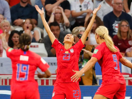 U.S. forward Christen Press (23) celebrates her 10th-minute goal against England.