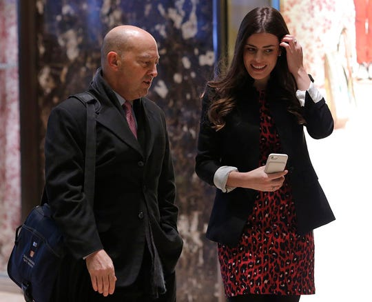 Retired Admiral James Stavridis (L), dean of Fletcher School at Tufts University is escorted by Madeleine Westerhout as he arrives at Trump Tower on December 8, 2016 in New York.