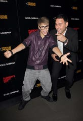 Justin Bieber and Scooter Braun attend the Fashion Night Out Dolce & Gabbana on Sept. 8, 2011, in New York. Braun discovered Bieber as a 12-year-old uploading singing videos to YouTube.