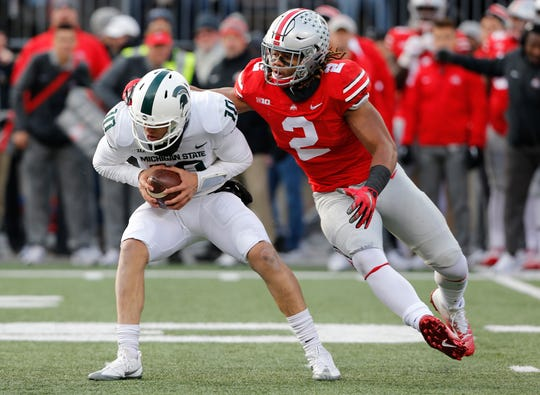 Ohio State defensive end Chase Young sacks Michigan State quarterback Messiah deWeaver during a game in 2017.