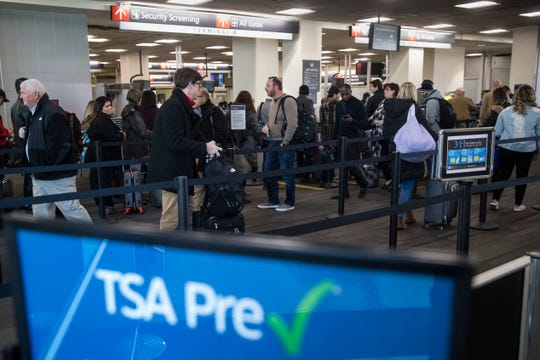 The Transportation Security Administration has put two of its officers on administrative leave following the discovery of a racist display in a baggage screening area.