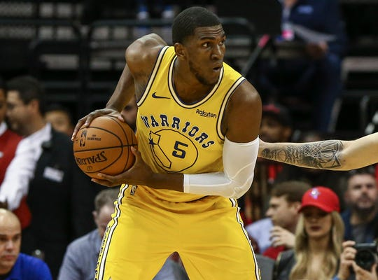 Kevon Looney re-signed with the Golden State Warriors for three years and $15 million.
