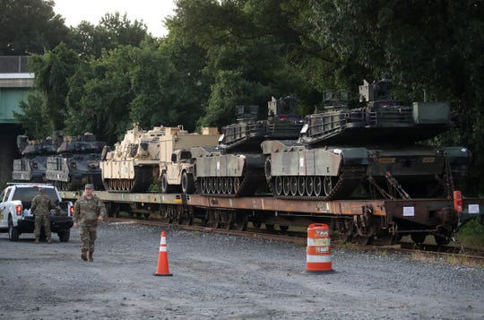 Two M1A1 Abrams tanks and other military vehicles sit on guarded rail cars at a rail yard on July 2, 2019 in Washington, DC. President Trump asked the Pentagon for military hardware, including tanks, to be displayed during the 4th of July Salute To America on the National Mall.