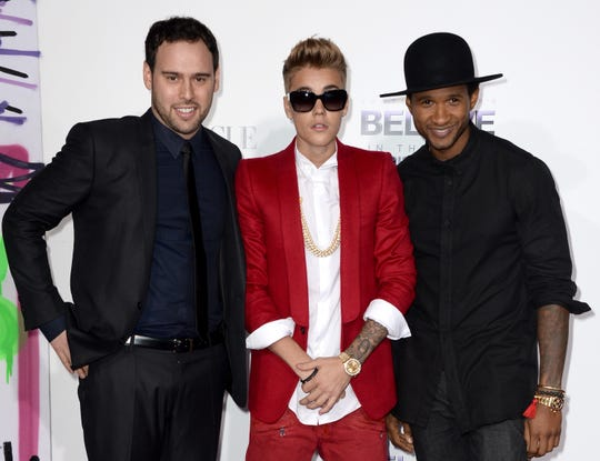"Scooter Braun, Justin Bieber and Usher arrive at the premiere of Open Road Films' ""Justin Bieber's Believe"" at Regal Cinemas L.A. Live on Dec. 18, 2013."