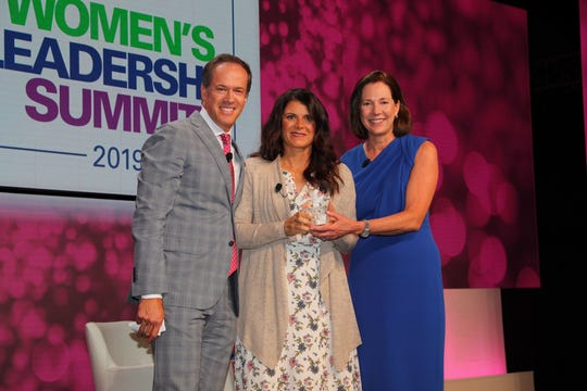 Mia Hamm (center), Olympic medalist, Team USA Soccer and FIFA Women's World Cup champion, accepts this year's KPMG Inspire Greatness Award from Dan Hicks, NBC Sports' Lead Golf Host & Play-by-Play Announcer, and Lynne Doughtie, U.S. Chairman and CEO of KPMG.