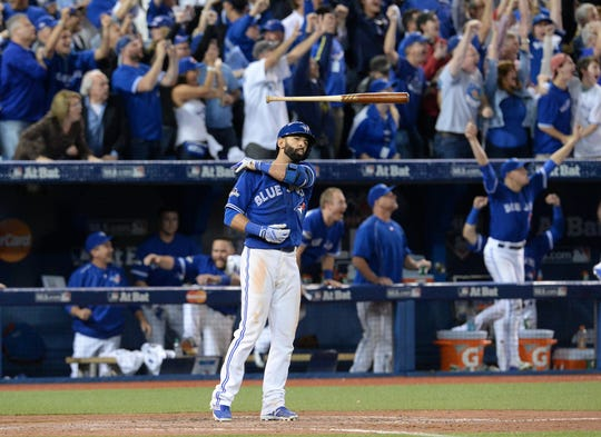Toronto Blue Jays Jose Bautista flips his bat after hitting a three-run home run against the Texas Rangers during the seventh inning in Game 5 of the 2015 American League Division Series in Toronto.
