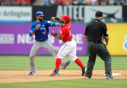 Rangers second baseman Rougned Odor punches the Blue Jays' Jose Bautista after Bautista slid in hard trying to break up a double play on May 15, 2016.