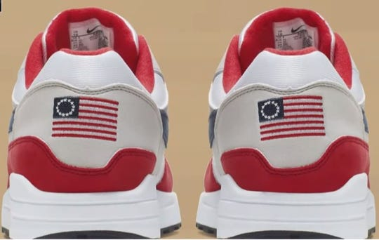 The heel of Nike's sneaker features a U.S. flag with 13 white stars in a circle, a design often referred to as the Betsy Ross flag.