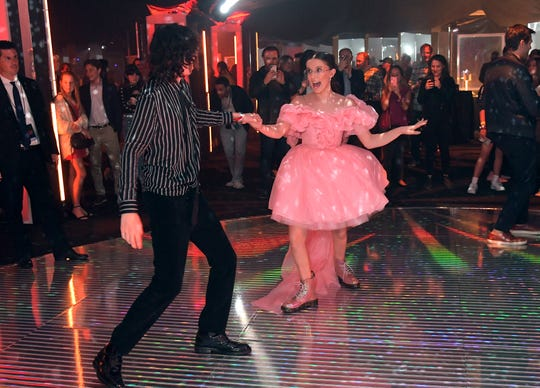 """Finn Wolfhard and Millie Bobby Brown get the dance party started at the """"Stranger Things"""" Season 3 premiere party in Santa Monica."""