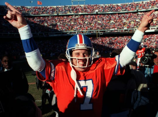John Elway celebrates victory in the 1989 AFC Championship Game.