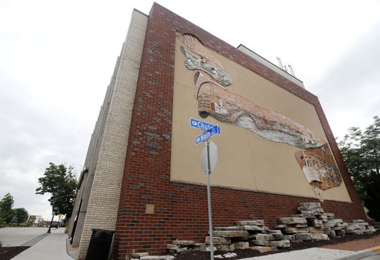 The mural on the east side of the former Menasha City Hall at 140 Main St. will remain as the property is redeveloped.