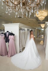 Employee Lisa Milburn shown in a wedding gown by Matthew Christopher. Castle Couture offers thousands of options for brides looking for a wedding gown. The 12-year-old full-service provider also offers prom, pageant, and evening gowns.    
