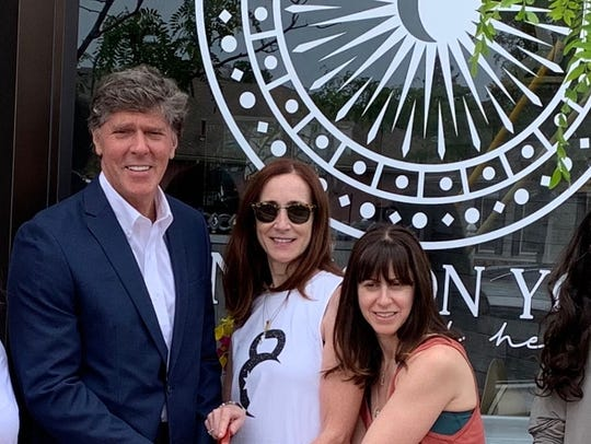 Long Branch Mayor John Pallone joins Sun Moon Yoga And Healing owners Emily Sobel and Lisa Horan-Sockol at the grand opening.
