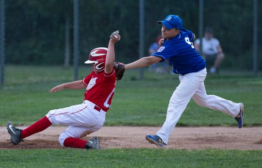 Brick's Lou DiBiase puts the tag on  Mike Kisseberth as he tries to take third. Holbrook plays Brick in a District 18 Little League game in Brick on July 2, 2019
