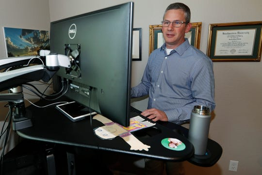 Software engineer Joe Wilson works in his home in Highlands Ranch, Colo. The tariffs that the Trump administration has placed on thousands of products imported from China and retaliatory duties placed on U.S. goods are affecting many small businesses, even if they're not importers or exporters. Wilson might have to put off hiring freelancers if he feels the ripple effects of tariffs that his customers must pay.