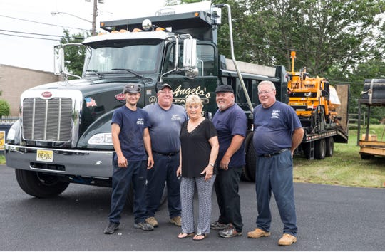 Left to right are the Ciaglia family, Michael Jr., Michael Sr., Rita, president, Angelo, and Mark. Not pictured is Anthony. Angelo's Paving Inc., a West Long Branch-based business that performs paving work throughout Monmouth and Ocean Counties, performs work at a business near Richmond Avenue.     