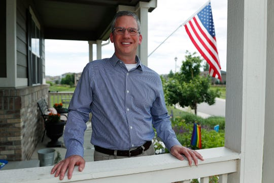 Software engineer Joe Wilson poses for a photo outside his home in Highlands Ranch, Colo.  The tariffs that the Trump administration has placed on thousands of products imported from China and retaliatory duties placed on U.S. goods are affecting many small businesses, even if they're not importers or exporters. Wilson might have to put off hiring freelancers if he feels the ripple effects of tariffs that his customers must pay.