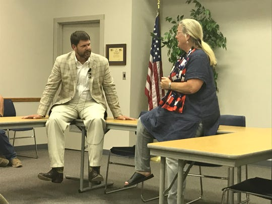 U.S. Rep Jodey Arrington, R-19th Congressional District, listens to Geri Massey, commander of the Women Veterans of America Chapter 49 in Abilene, as she asks a question about veteran healthcare and the future of the Veterans Affairs healthcare system during a town hall meeting in Anson on Wednesday.