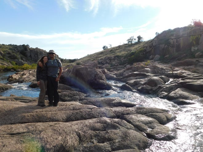 """Ronald """"Ron"""" Sanchez, Jr., and his girlfriend, Brenda Kelley, are seen here hiking in the Wichita Mountains National Wildlife Refuge in Oklahoma in October 2018. The couple met in 2017 in a hiking club."""