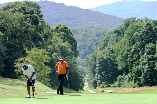 James Bowditch, of Charlotte, putts his ball as Ray Thomas, of Alabama, looks on during the amateur round of the first day of the 59th Skyview Annual Pro/Am Golf Tournament at the Asheville Municipal Golf Course on Tuesday, July 10, 2018. Thomas said that he has been coming to Asheville for the tournament for 50 years.