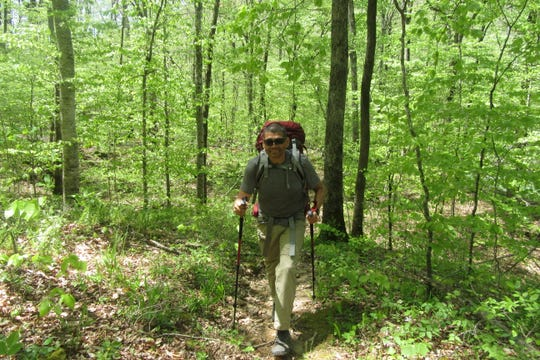 "Ronald ""Ron"" Sanchez, Jr., is seen here hiking in April 2018 on the Ozark Highlands Trail in Arkansas while preparing for an Appalachian Trail thru-hike. He was murdered on the Appalachian Trail May 11."