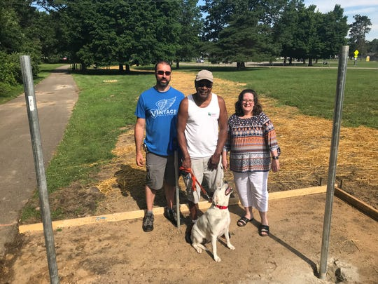 Fencing is going up around the new Home Run Dog Park opening in Battle Creek this summer. Members of the Friends of Calhoun County Dog Parks including, from left, Jeff Breedlove, Matthew Downing and Deb Fryar, raised $40,000 for the project. Autumn the dog will be one of the dogs enjoying the park when it opens in August.
