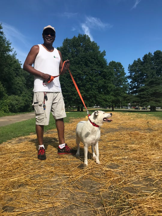 Matthew Downing, a member of the Friends of Calhoun County Dog Parks, with his dog Autumn. The committee raised $40,000 to open up a dog park in the city this summer.