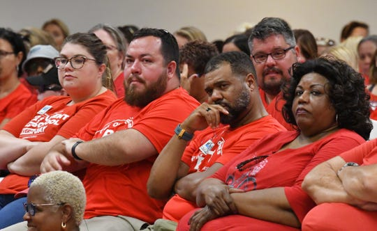 About 900 teachers and supporters showed up for a June 24 vote on dueling proposals for teacher pay. The school board voted 4-1 to back the district's plan over a union plan endorsed by an impartial magistrate.