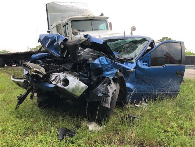 At least one person was injured in a crash that closed all lanes of Interstate 95 near Palm Bay Tuesday evening.