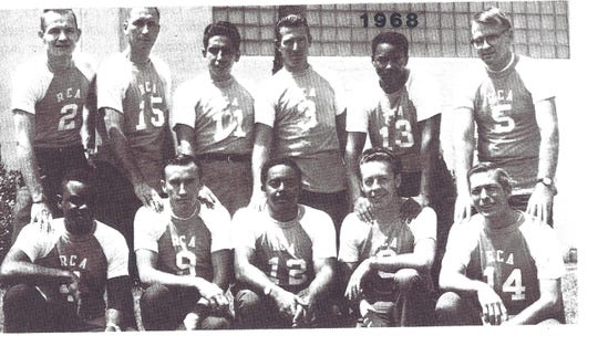"Julius Montgomery (front row, center) with the RCA softball team at Cape Canaveral in 1968. Ten years earlier, on Montgomery's first day at the Cape, he said, ""Nobody would shake my hand."""